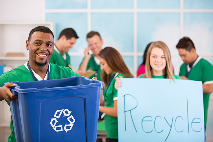 People in Green Shirts Recycling